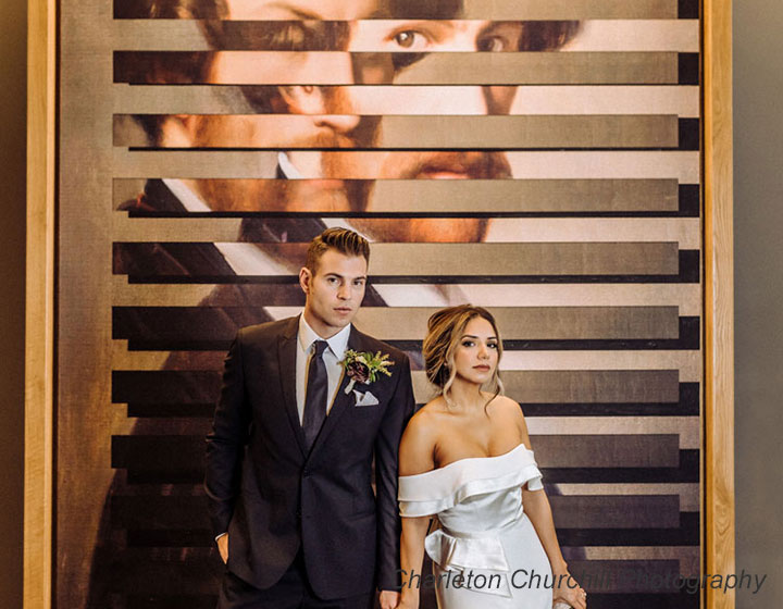 Bride & Groom in front of art